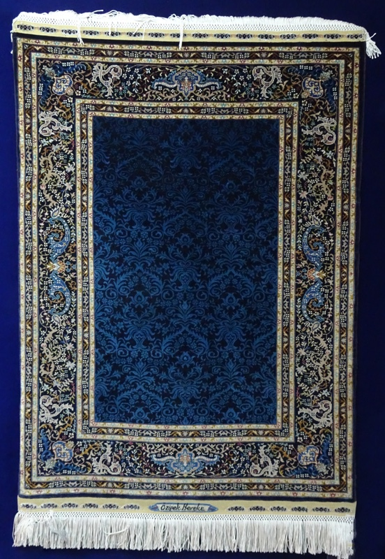Blue and gold silk rug